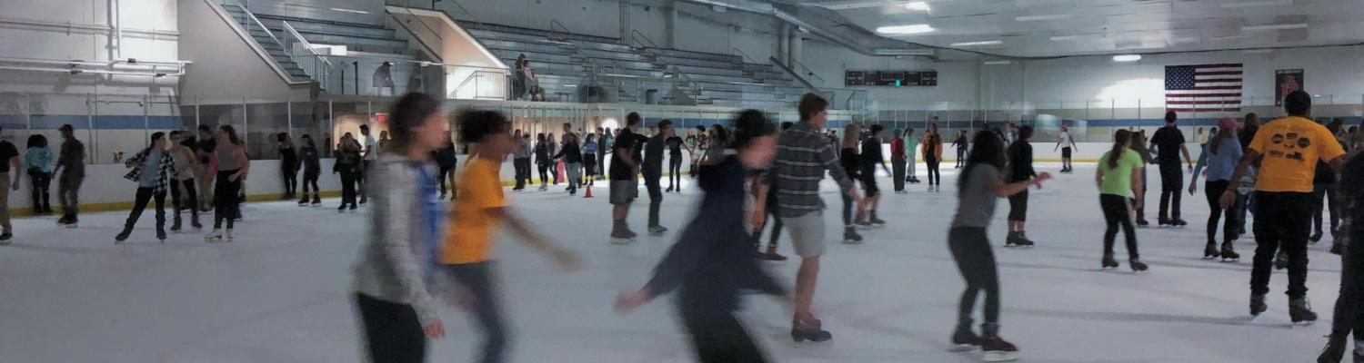 College students skating at the Ice Arena.