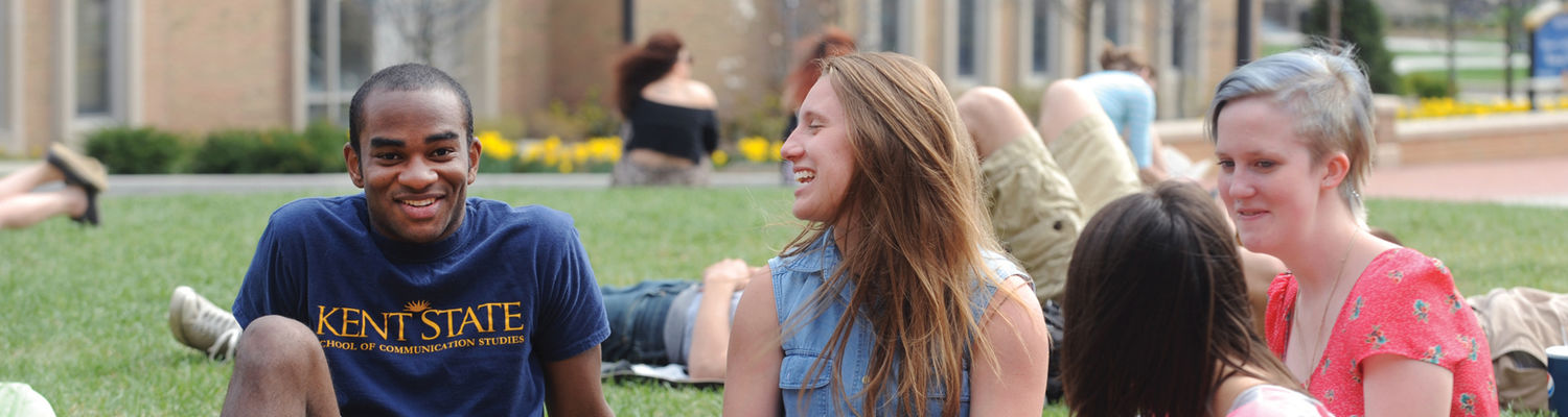 A group of students - including a comm studies major - relax in Risman Plaza.