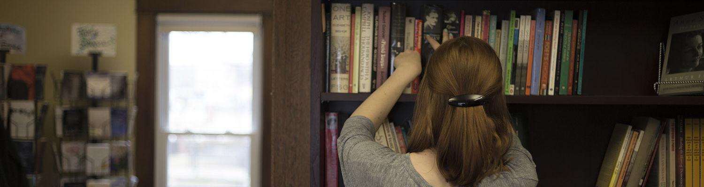 Woman at book shelf