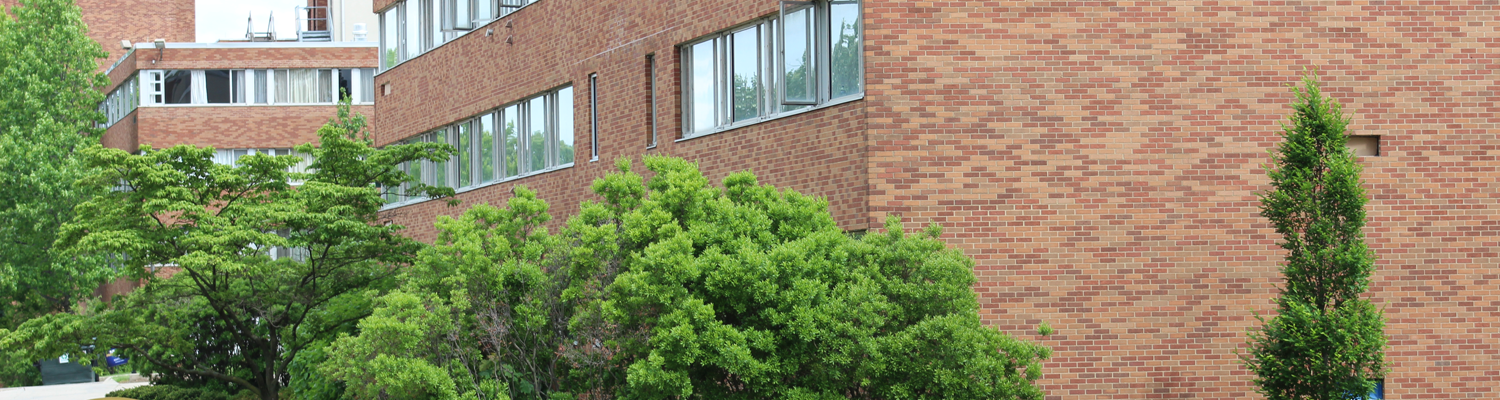 Outdoor shot of Fletcher Hall and surrounding shrubbery