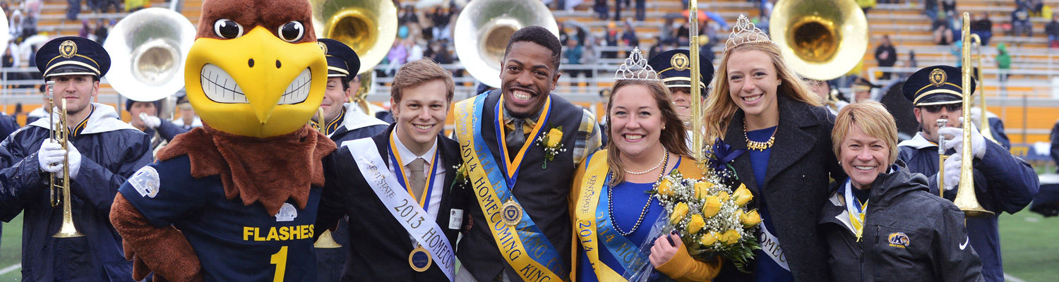 Dr. Warren at Homecoming with the king, queen and Flash