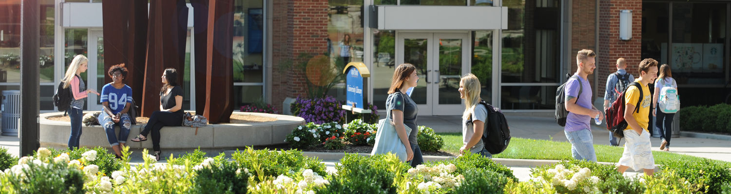 Students pass through Risman Plaza near the University Library.
