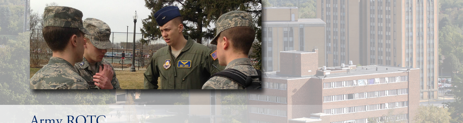 ROTC students in uniform stand outside talking to each other