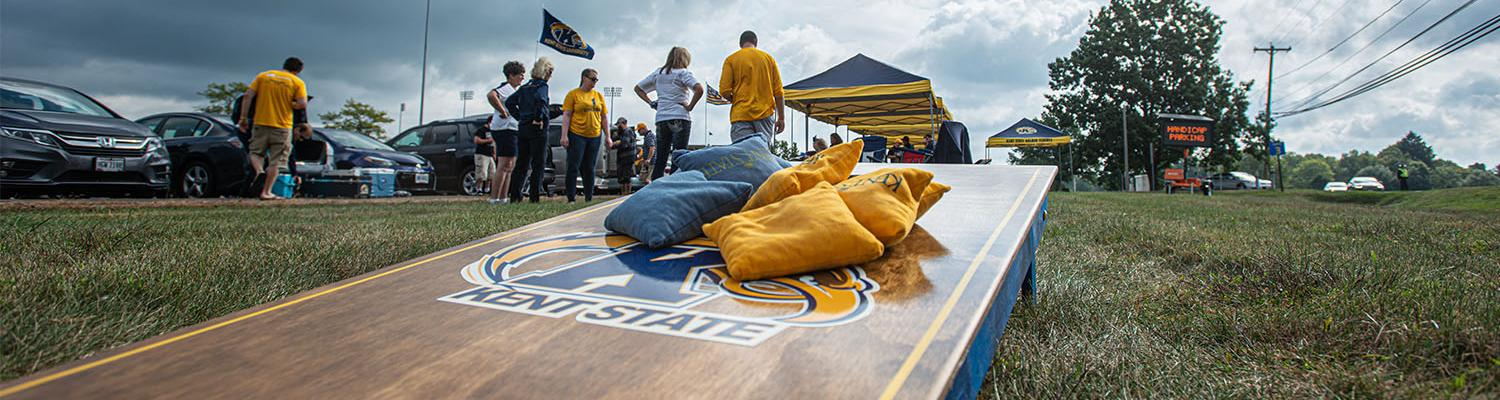Kent State alumni tailgate before Homecoming 2019 with a custom Kent State corn hole game.