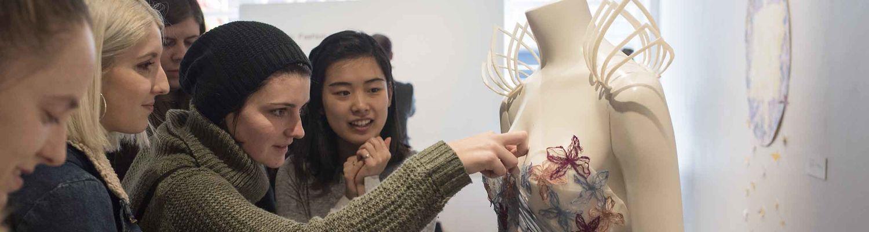 Fashion students admire new textiles.