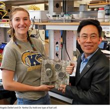 Angela and Dr.Du holding a fuel cell