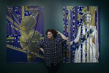 Portrait of artist April Bey with her artwork