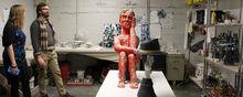Graduate Studio Crawl - Two people in a ceramics studio with ceramic sculptures