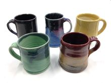 Ceramic mugs made by Kent State students and faculty