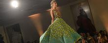 Model walks down runway at fashion show