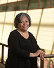 Dean Barbara Broome stands near the atrium in Henderson Hall