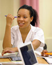 A nursing student listens intently during a lecture