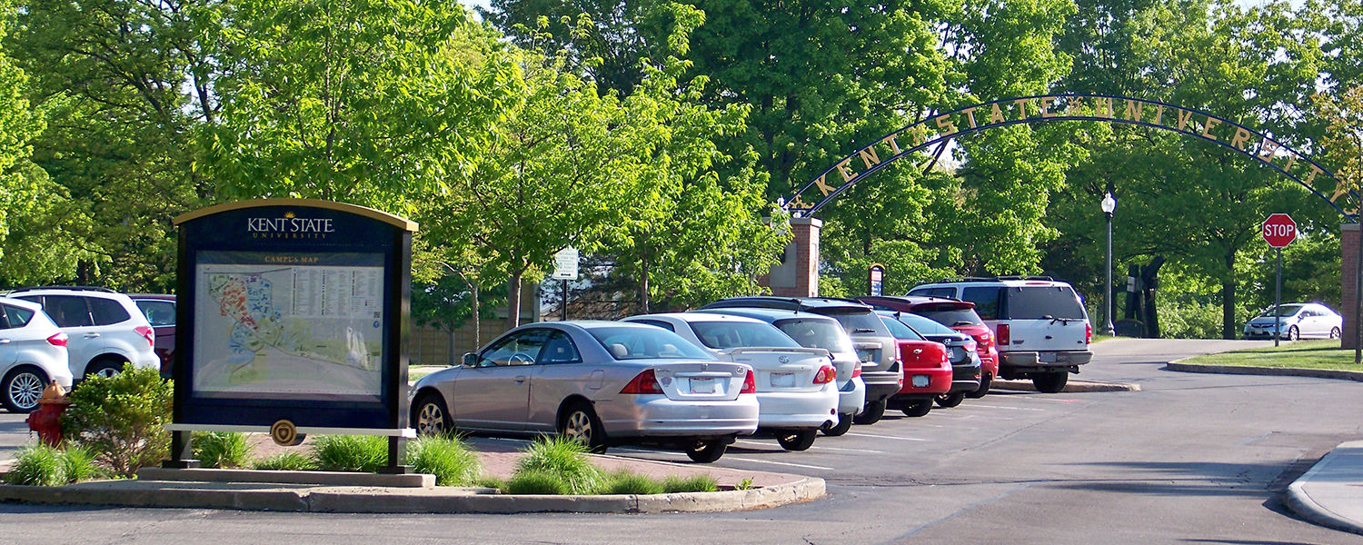 Overlooking Janik Dr.  The lot is filled with cars.