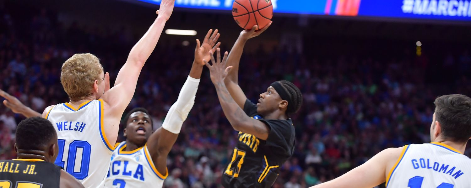 Kent State guard and Mid-American Conference Tournament MVP Jaylin Walker shoots over two UCLA defenders.
