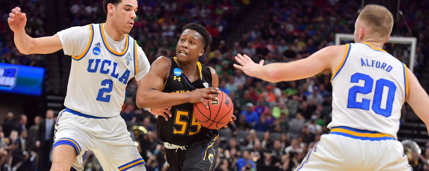 Kent State guard Kevin Zabo makes a move to drive past UCLA players.