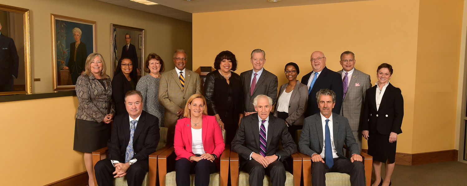 Picture of the members of the Board of Trustees, President Beverly Warren, and Vice President Charlene Reed on May 31, 2017
