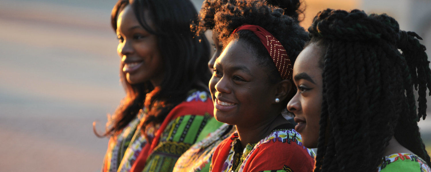 Members of an African Dance Ensemble pose on the Risman Plaza during a video shoot for the Kent State re-branding.