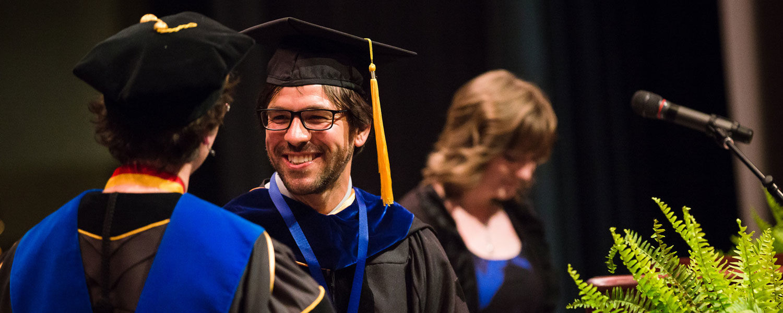 Matthew Lehnert receives the Distinguished Teaching Award in 2016.