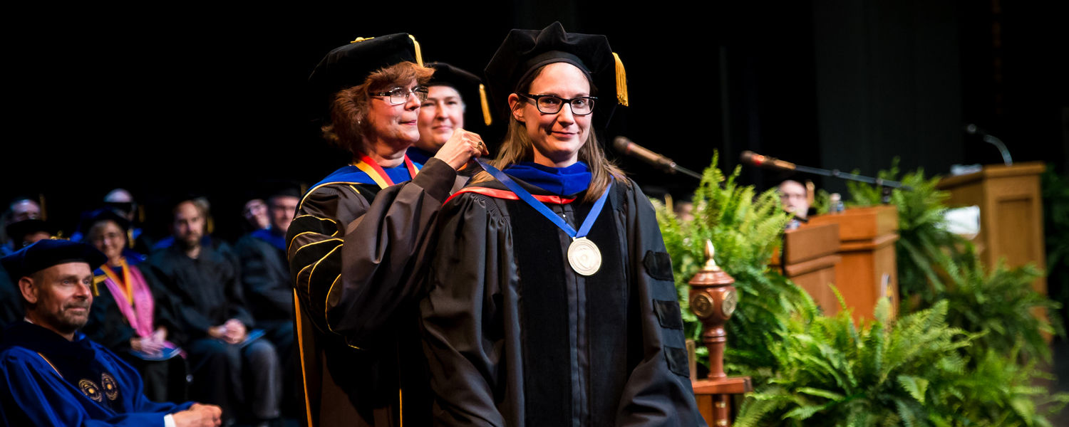 Dr. Lindsay Starkey receives her Distinguished Teaching Award medallion at Spring Commencement.