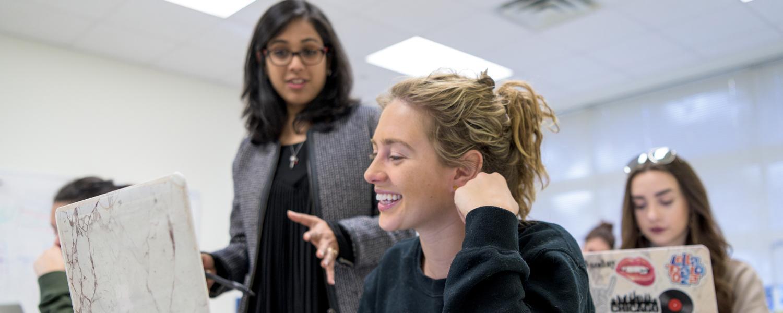 Merchandising student in classroom with professor