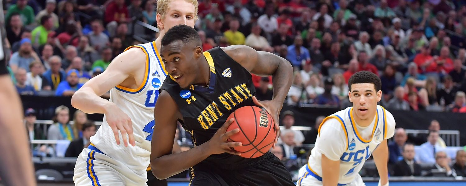 Kent State forward Jimmy Hall looks for room to get past a UCLA defender.