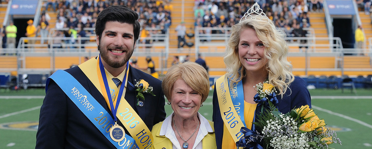 Kent State President Beverly Warren poses for photographs with 2016 Homecoming King and Queen winners Corey Patterson and Emily Badock.