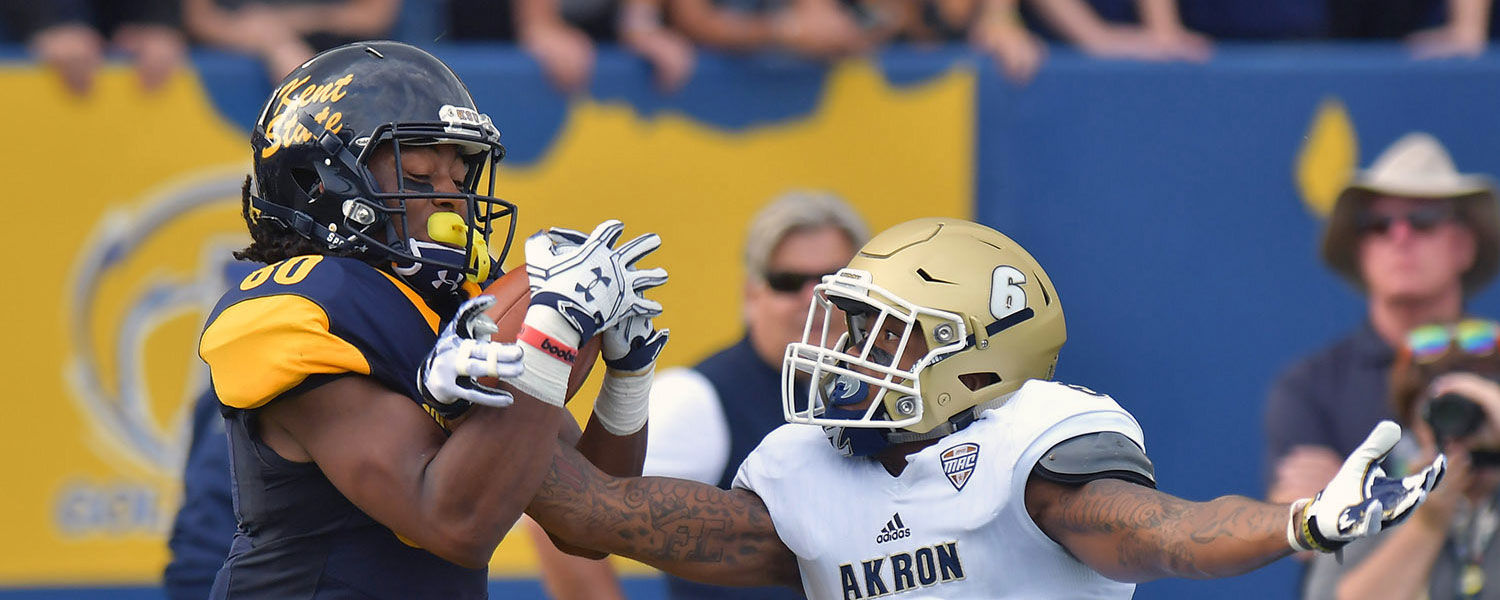 Kent State wide receiver Johnny Woods pulls down a reception over an Akron defender during the 2016 Homecoming game against the Akron Zips at Dix Stadium.