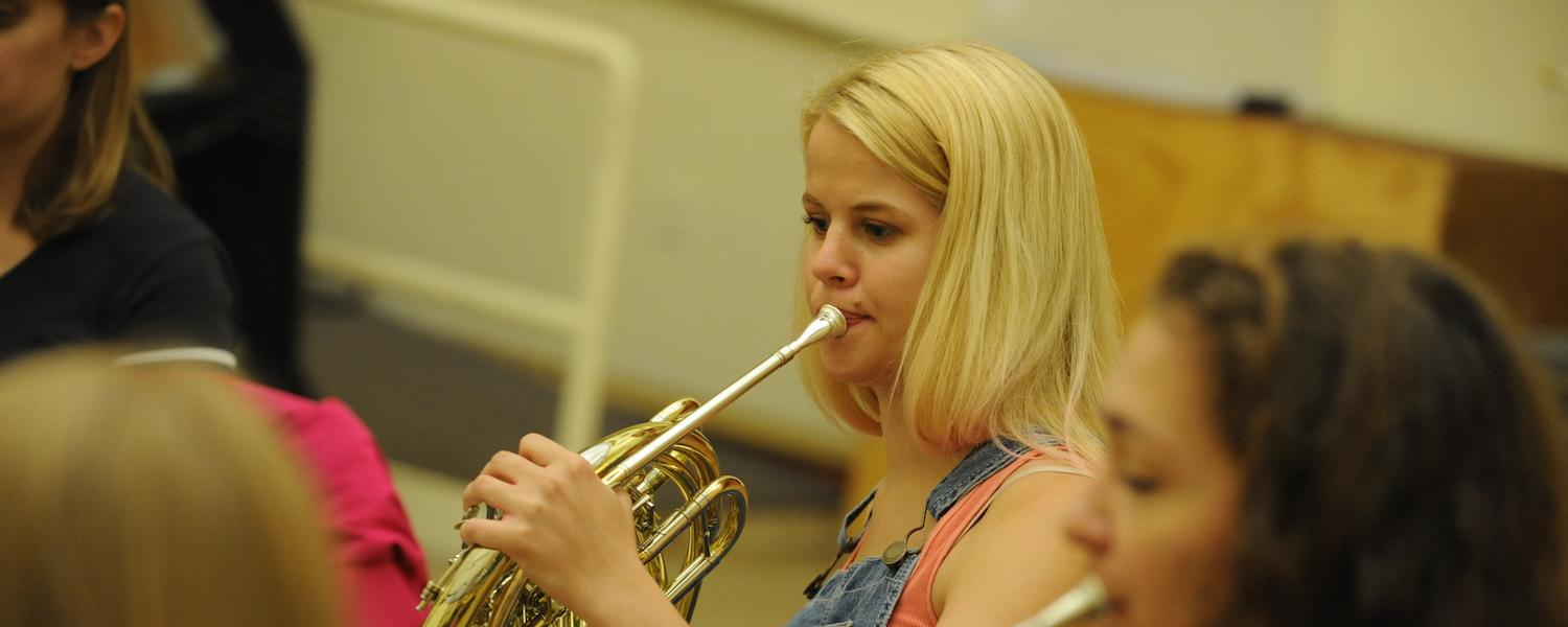 A KBMF horn student during a chamber music rehearsal