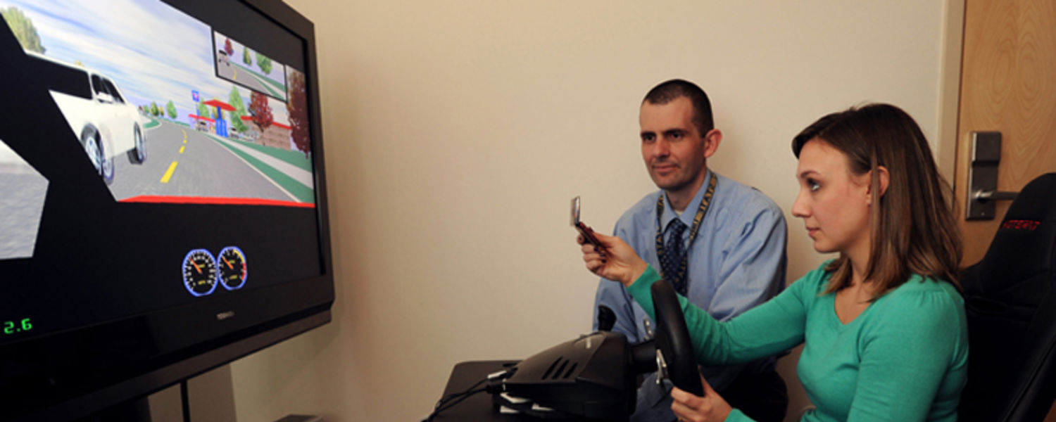 Dr. John Gunstad Observes a participant in a study of attention and driving performance.