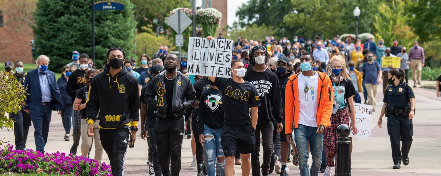Students participating in a Black Lives Matter march on campus.