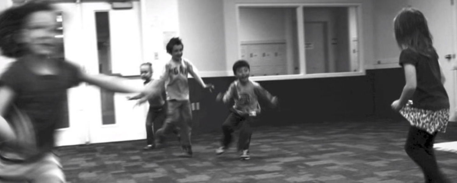 Children running - still from Day in the Life video