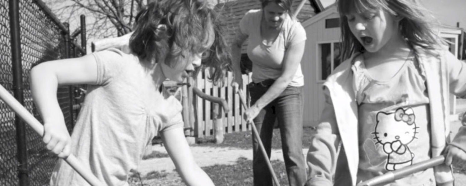 Children raking leaves - still from Day in the Life video