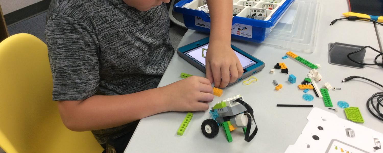 Boy building robot