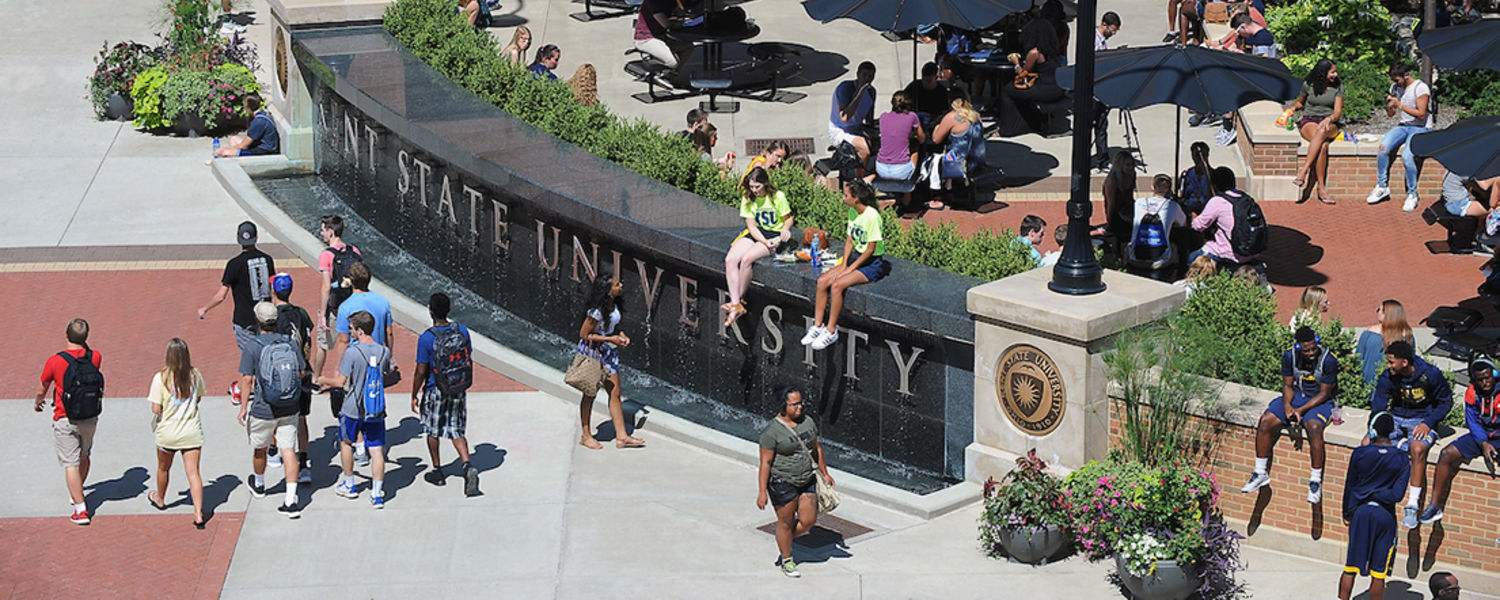 students lounging at risman fountain
