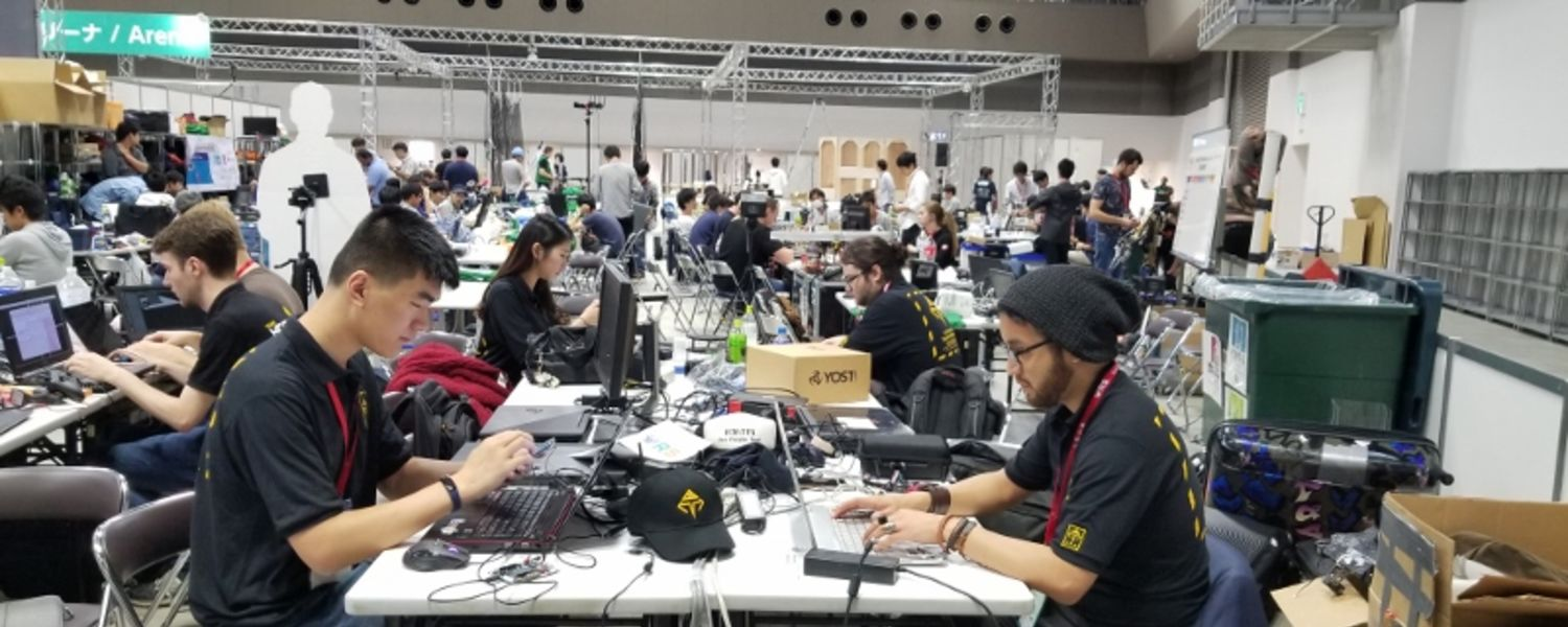 Photo of ATR Lab Robotics Team members at Competition in Japan