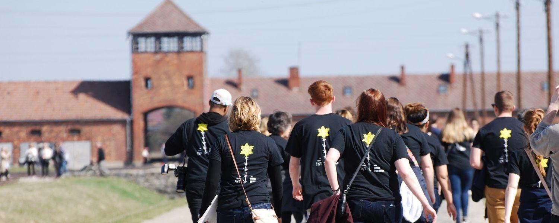 Students walking through Auschwitz