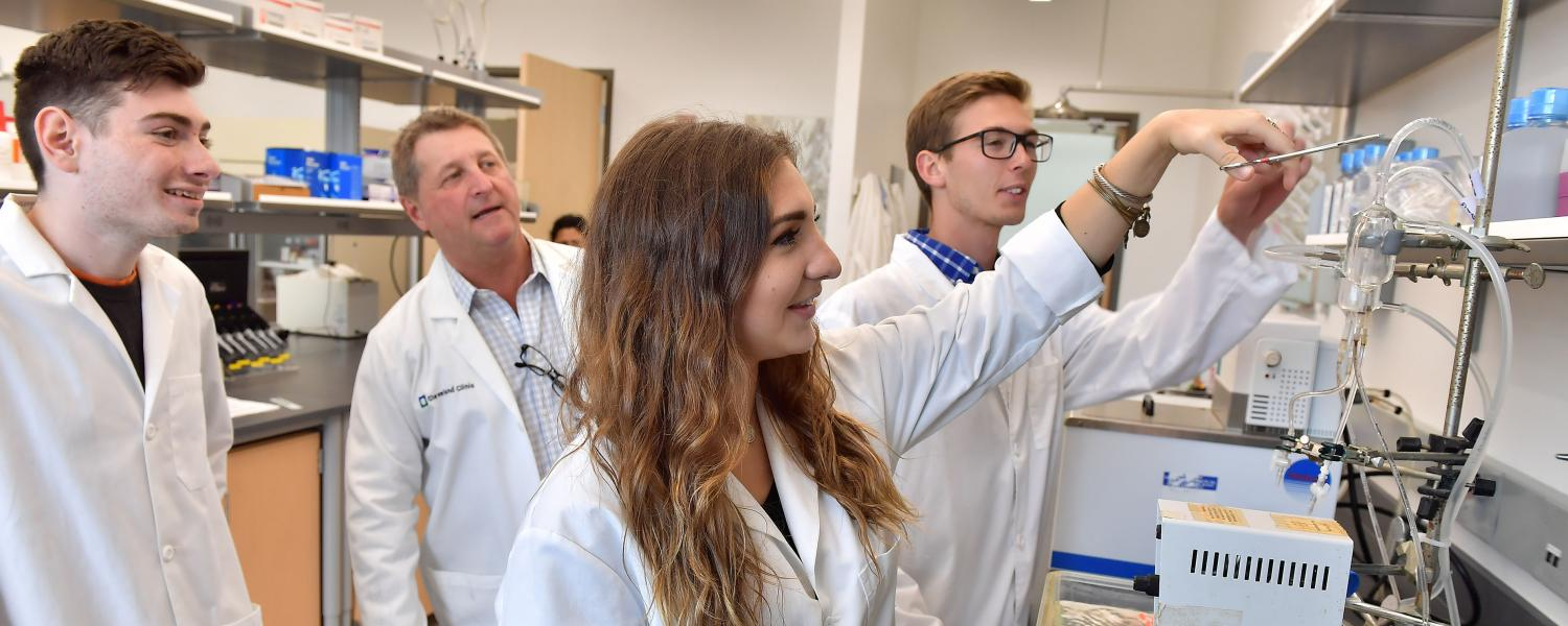 Kent State University students and faculty in Biological Sciences performing an experiment