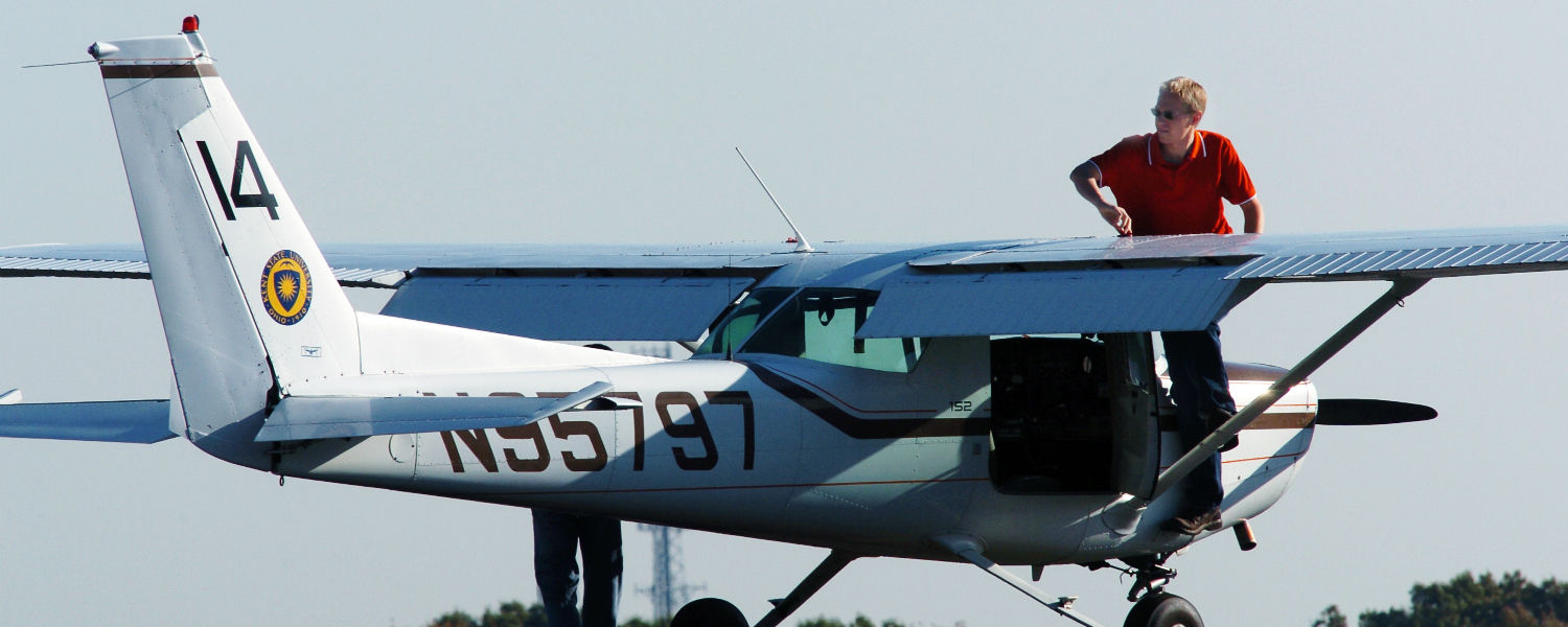 A Kent State airplane sits on the runway at the Kent State University airport. Kent State's aeronautics program operates at the Airport with a fleet of 23 single engine and two twin engine aircraft.