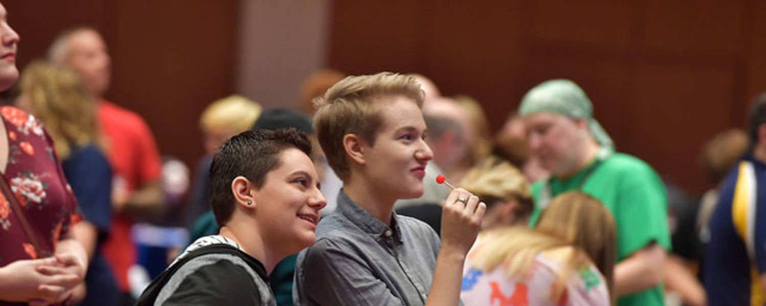 Diverse students watching a performance