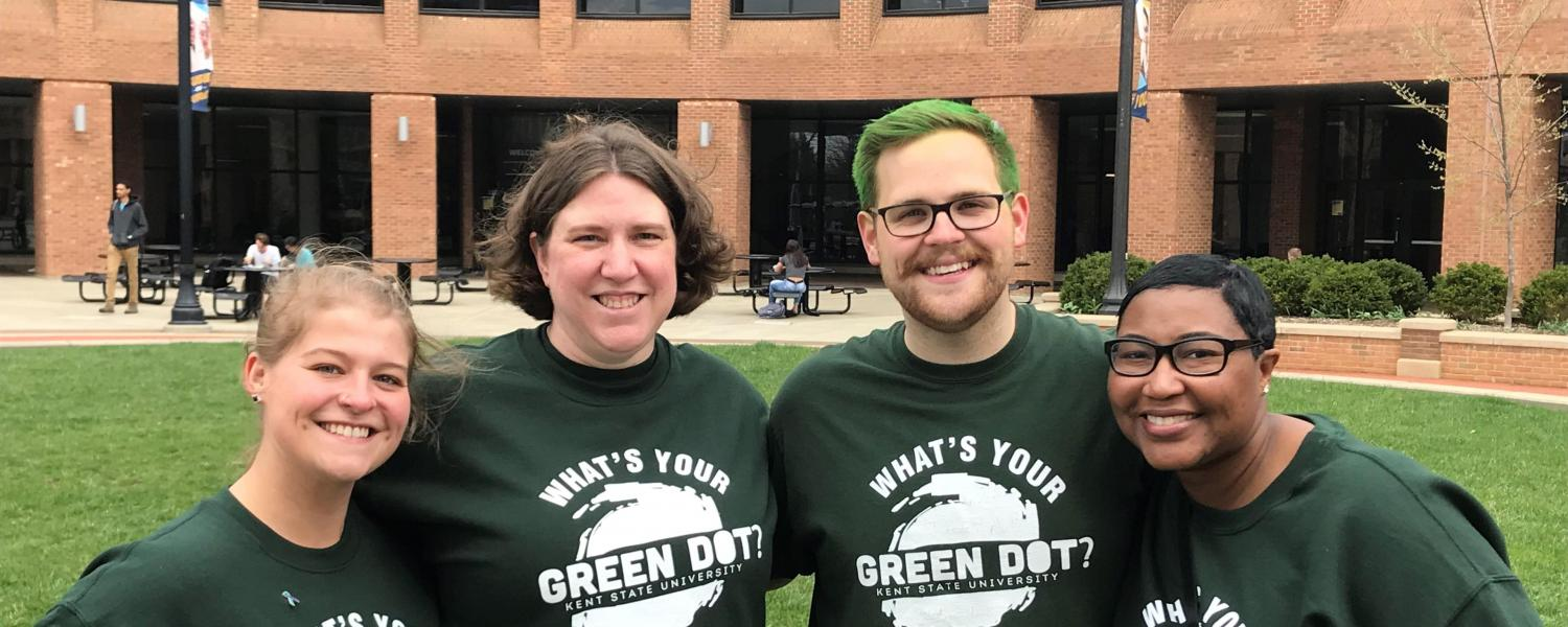 4 individuals wearing Green Dot shirts