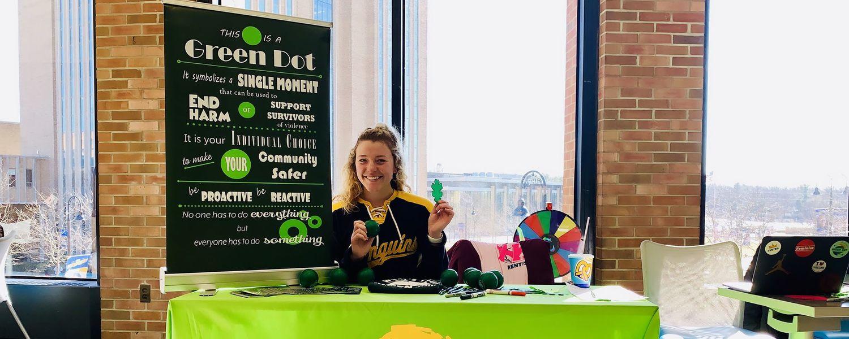 Woman at Green Dot Table at Kent Student Center