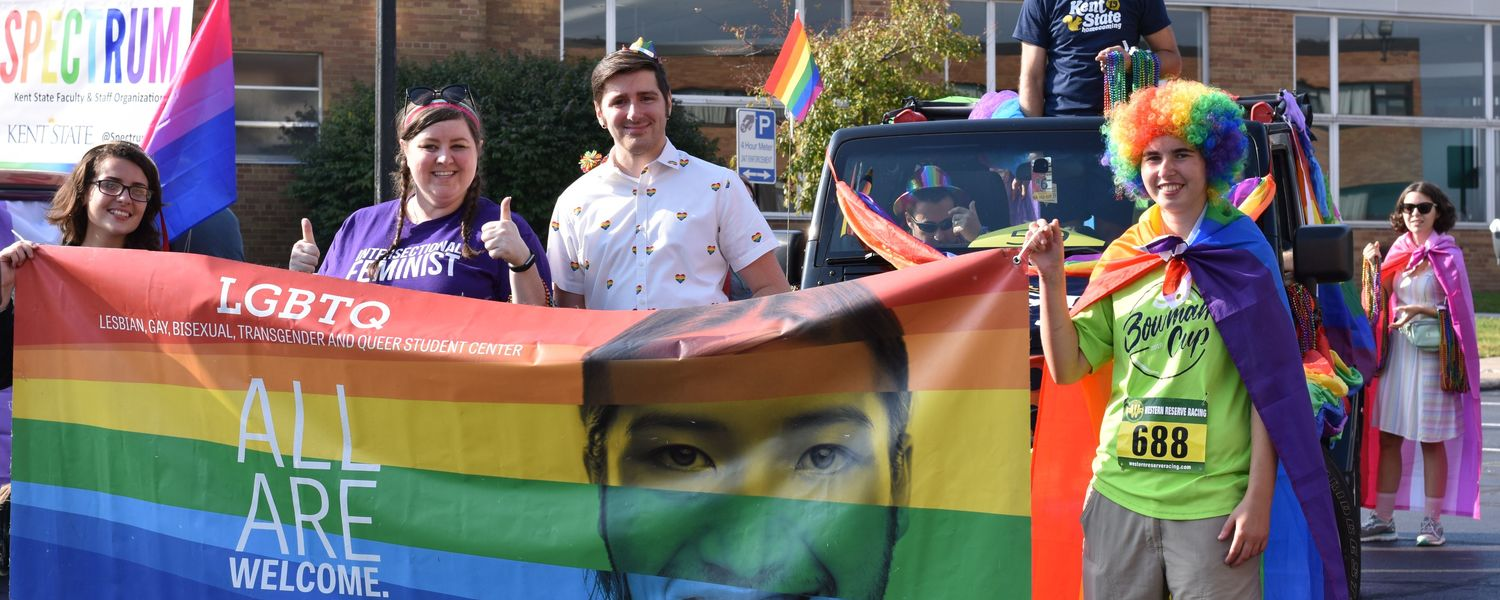 LGBTQ+ Center participants hold LGBTQ up flag at 2019 Homecoming