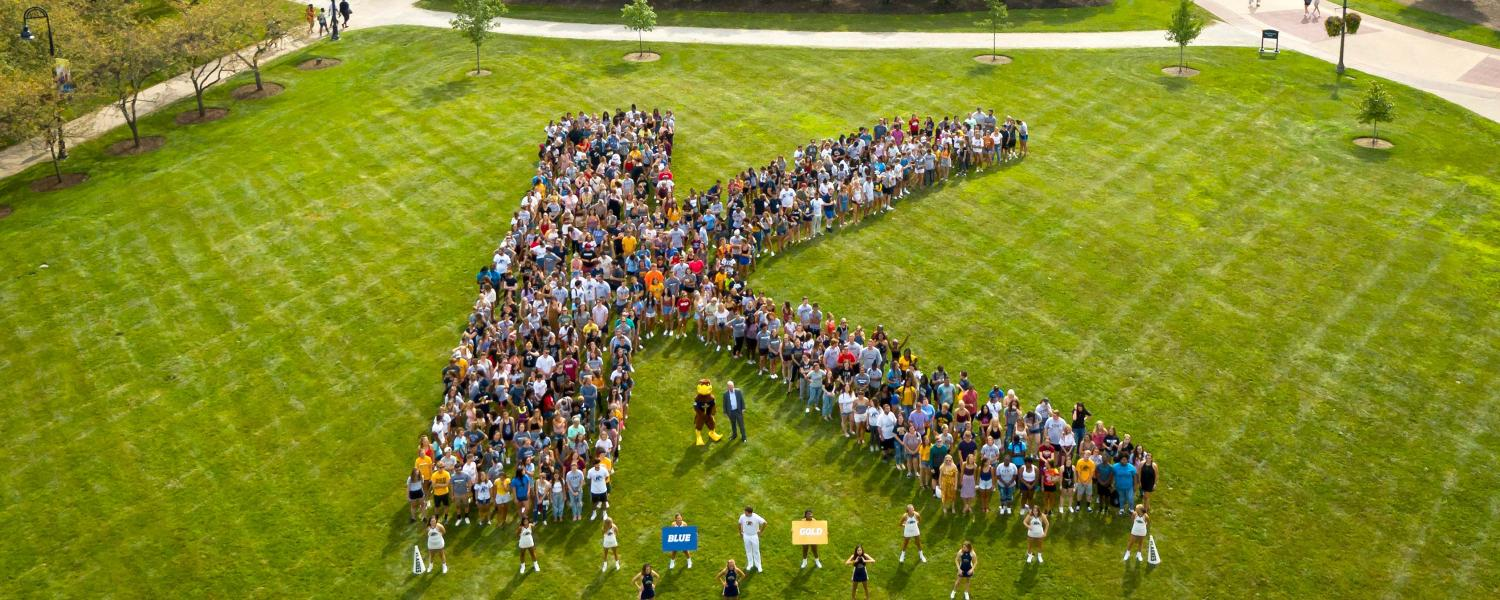 The class of 2023 forms a K on Manchester Field.