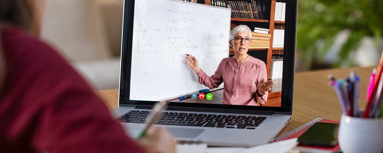 Online Teaching professor on laptop computer teaching student virtually digitally