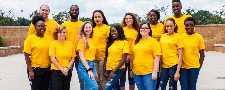 UB group photo yellow shirts