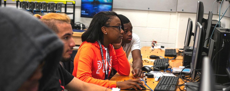 Upward Bound students work on computers