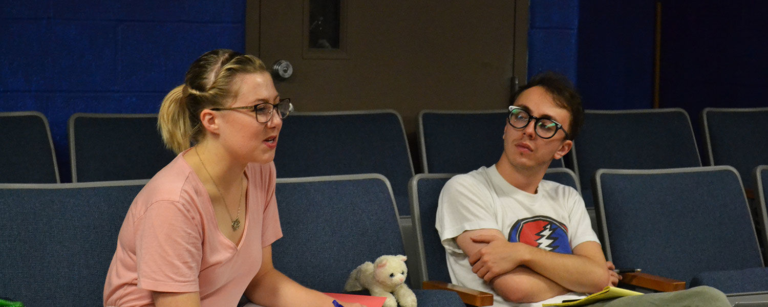 Kent State sophomore public relations major Emelia Sherin leads actors and volunteers through a rehearsal of her original play that brings heroin to life as a character.