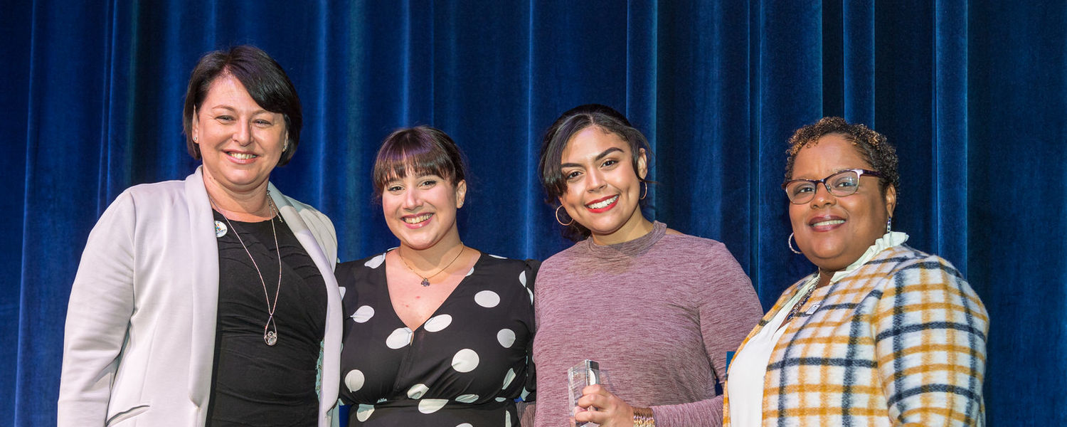 On behalf of Latinx in Theatre, Rafaela Clerle (second from left) and Bridgett Martinez (third from left) accept the 2020 Rozell Duncan Student Diversity Award from Dana Lawless-Andric (far left) and Sonya Williams (far right).