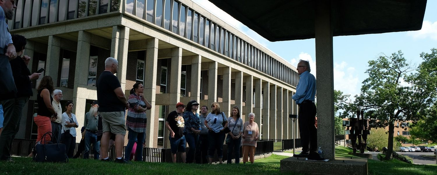 Alan Canfora (far right), who was shot on May 4, 1970, leads a guided tour of the historic May 4 site.