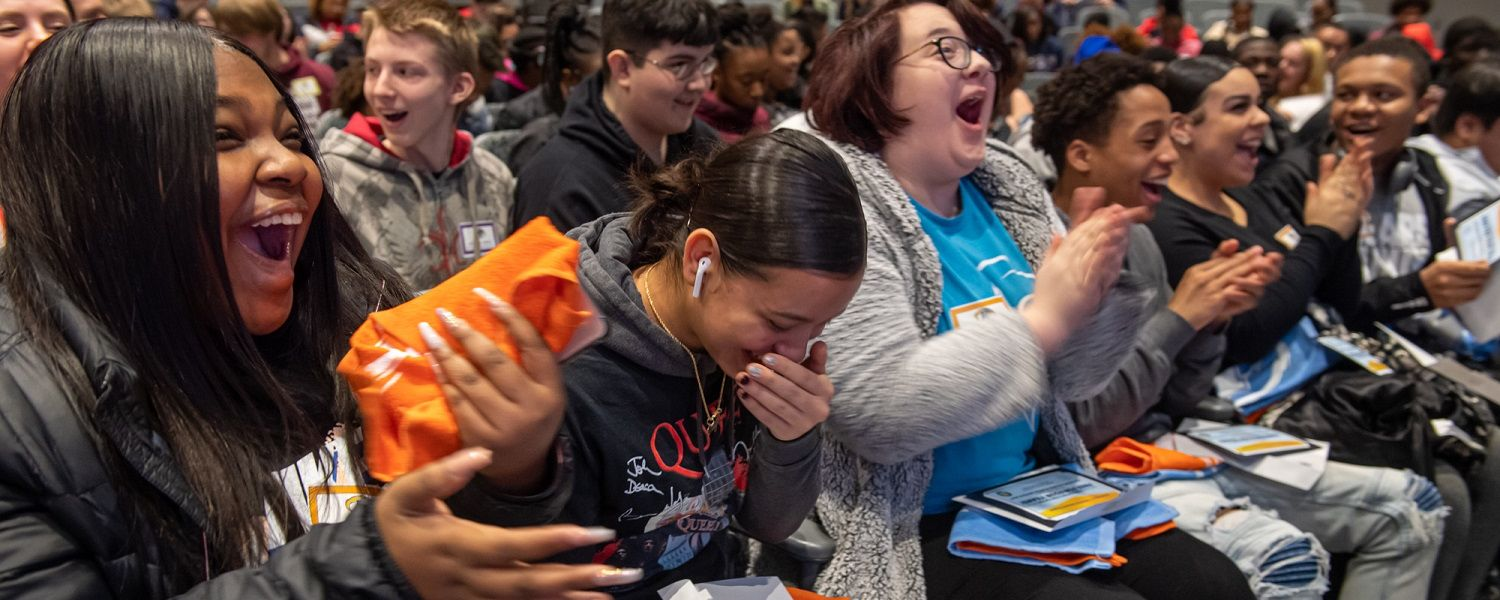 Students from the LeBron James Family Foundation's I PROMISE Network react to learning that Kent State University will offer eligible students free tuition for four years and free room and board for one year.